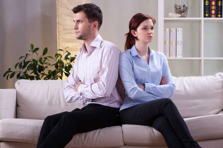 Angry marriage after quarrel in living room photo