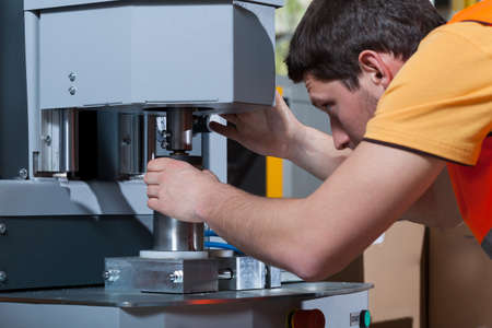 factory machine: Machine operator concentrating at his work
