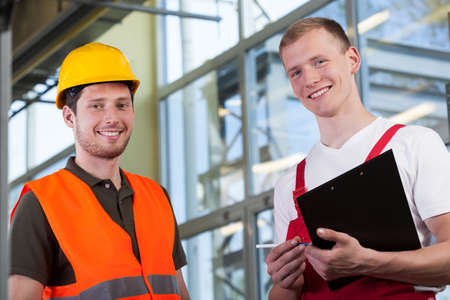 safety vest: Portrait of a factory workers and the project manager