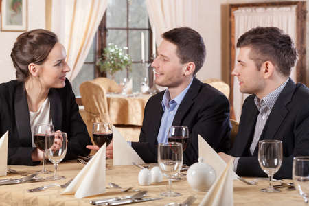 Horizontal view of business meeting in a restaurant photo