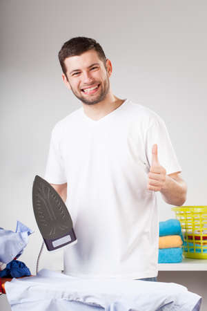 A happy man helping with household chores photo