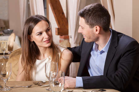 Horizontal view of a couple talking in a restaurant photo