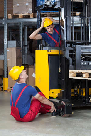 Vertical view of an accident on a forklift photo