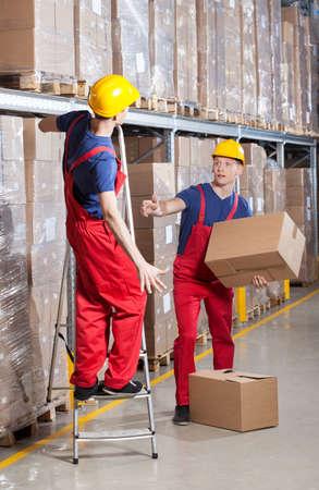 warehouseman: Storekeeper having accident on a ladder, vertical