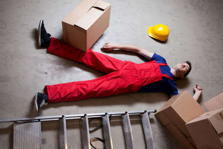 storekeeper: Storekeeper lying on the floor after accident