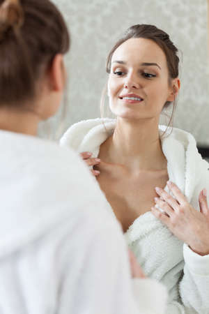 Happy woman watching results of a skin treatments Stock Photo