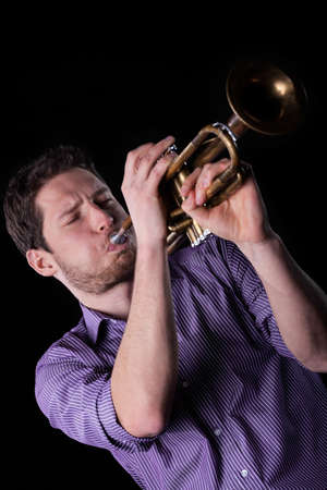 trumpeter: Close-up of a young man playing a trumpet