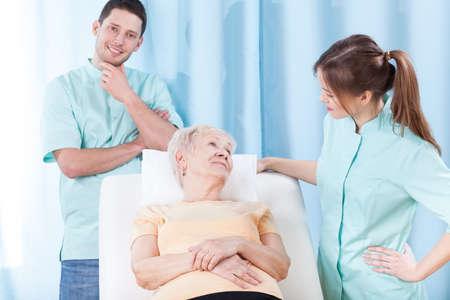 hospital patient: Elderly patient and her doctors in hospital Stock Photo