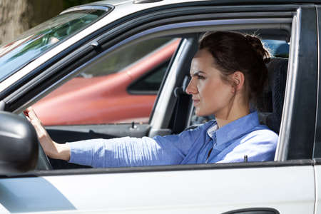 Horizontal view of angry woman in a traffic jam