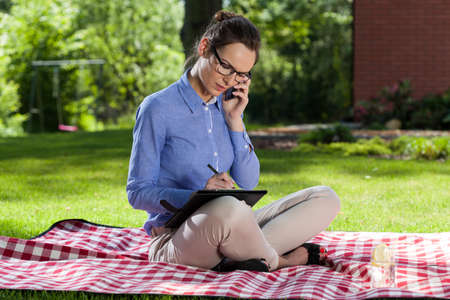 Beautiful businesswoman working outdoors on a sunny day photo