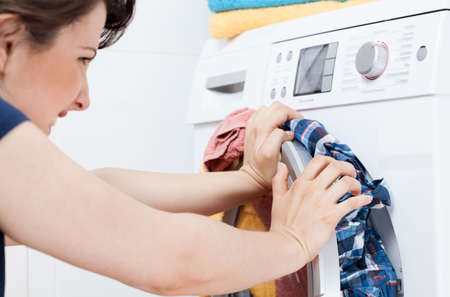 Horizontal view of young housekeeper learning to launder