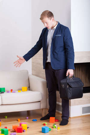 Angry businessman coming back home and see mess photo