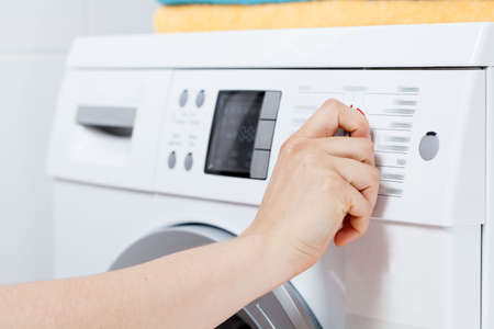 Horizontal view of turning on the washing machine Stock fotó - 29425379
