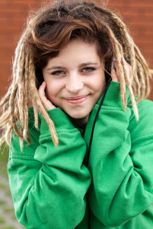 dreads: Young happy rasta girl with dreads smiling Stock Photo