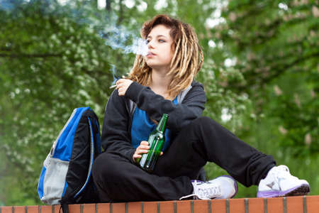 dreads: Rude girl smoking marijuana and drinking beer out of school