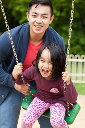 family fun day: Father spends time with his cute daughter on the playground