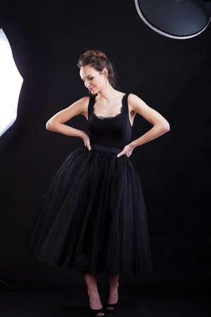 showbusiness: Female model in black dress during photo session