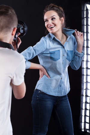 showbusiness: Photographer and young model working during photo session