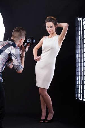 Elegant young woman posing at camera, vertical photo