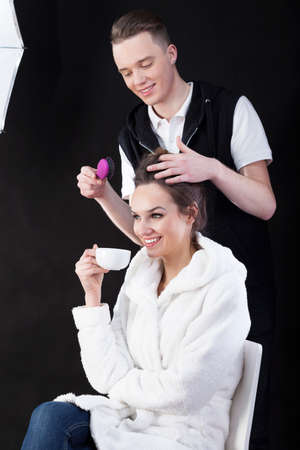 photo shooting: Young hairdresser and female model before photo shooting