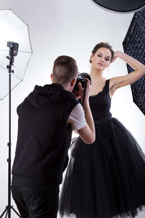 showbusiness: Attractive female professional model at work, vertical