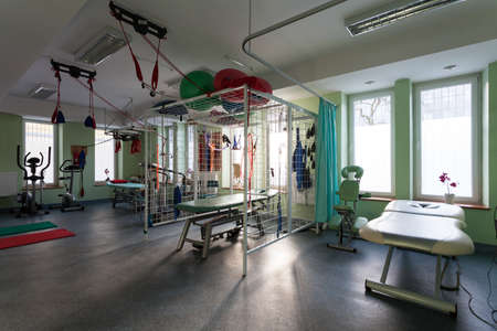 Rehabilitation room with medical equipment at physiotherapy clinic photo