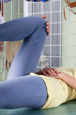 massage table: Close-up of a rehabilitation of twisted knee Stock Photo