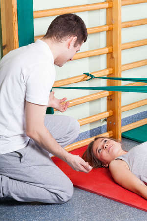 Vertical view of a rehabilitation exercises with physiotherapist photo