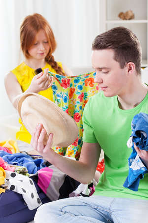 choosing clothes: Girl and boy choosing clothes for vacation