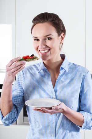 Housewife tastes prepared by himself healthy snack photo