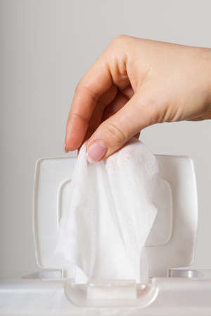 wipe: Close-up on hand taking tissues out of the box