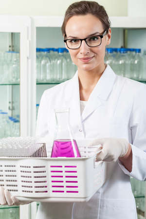 Portrait of a female chemist working in laboratory photo
