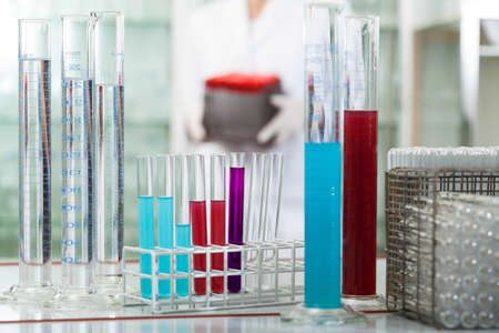 Set of a test tubes in rack wit colorful liquids photo