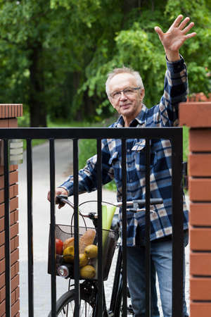 flannel: Smiling male cyclist in flannel shirt waving hello Stock Photo