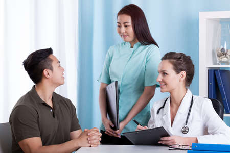 asian medical: Horizontal view of Asian patient during medical consultation Stock Photo
