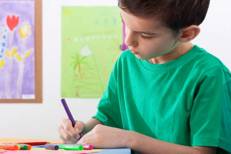 art lessons: A young boy paints on art lessons