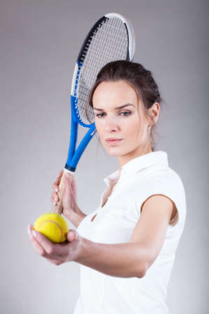 sportsperson: A beautiful woman with a ball and a tennis racket Stock Photo