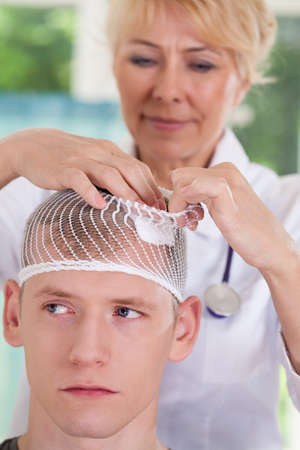 bandage wound: Patient with head wound at doctors office