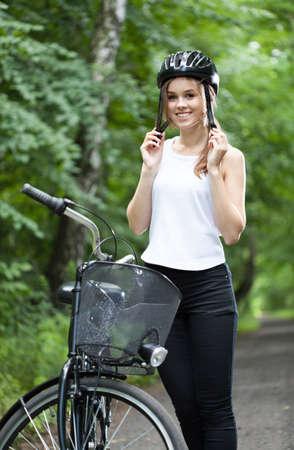 bicycle helmet: Girl ready for bicycle trip wearing helmet Stock Photo
