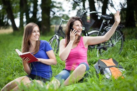 glade: Girls during relaxing on a glade, horizontal