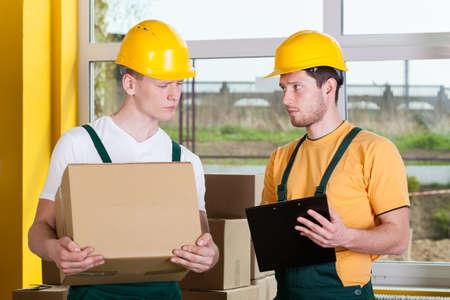 warehouseman: Young storekeepers during work at warehouse, horizontal