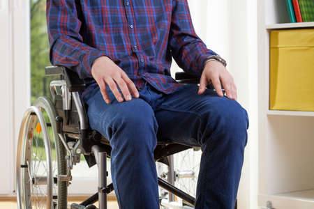 capable: Capable man in shirt is sitting on wheelchair  Stock Photo