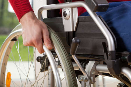 capable: Close-up on wheelchair of capable disabled man Stock Photo
