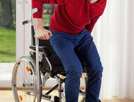 get help: Capable disabled trying to get up from the wheelchair