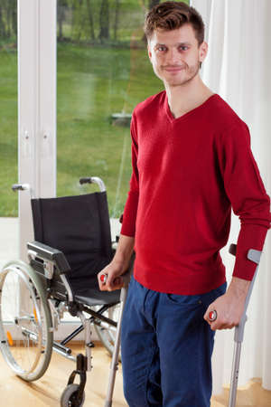 capable: Capable disabled man standing with crutches Stock Photo