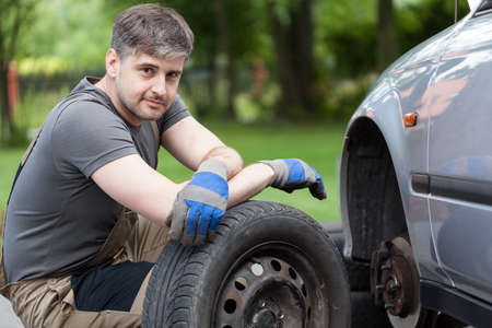 auto lift: Horizontal view of a car mechanic working outdoors