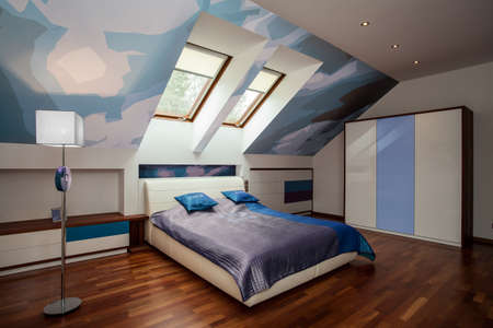 Interior of blue and white bedroom in the attic photo
