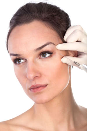 preventive: The doctor injects liquid wrinkle preventive young woman Stock Photo