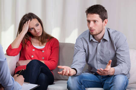 Young marriage in crisis trying solve problem during psychotherapy Stock Photo - 30023941