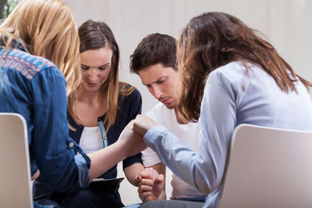 Addicted people holding hands on special group therapy Stock Photo - 30023998